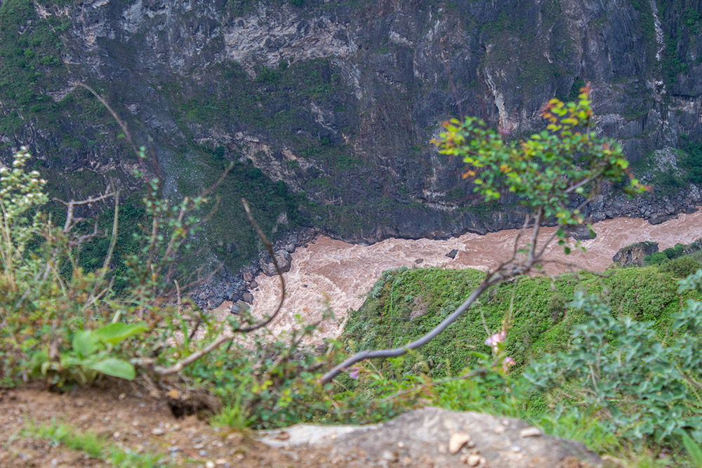 Looking down a cliff at Tiger Leaping Gorge