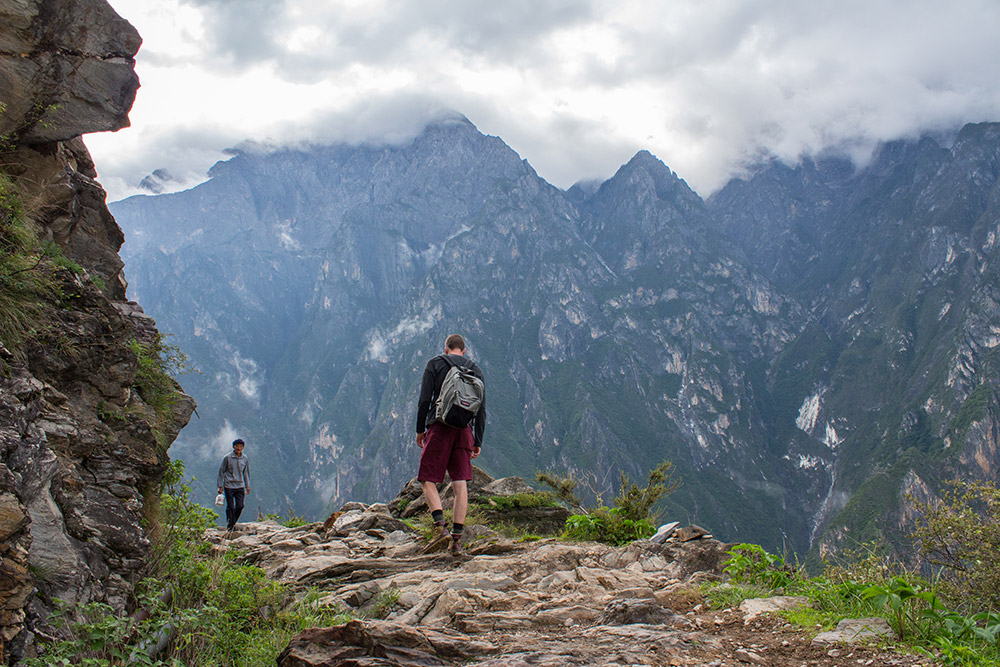 Crossing a local at Tiger Leaping Gorge