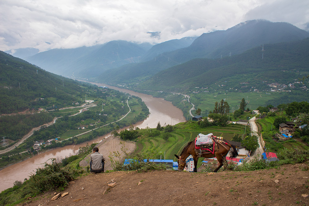 Man and mule at Tiger Leaping Gorge