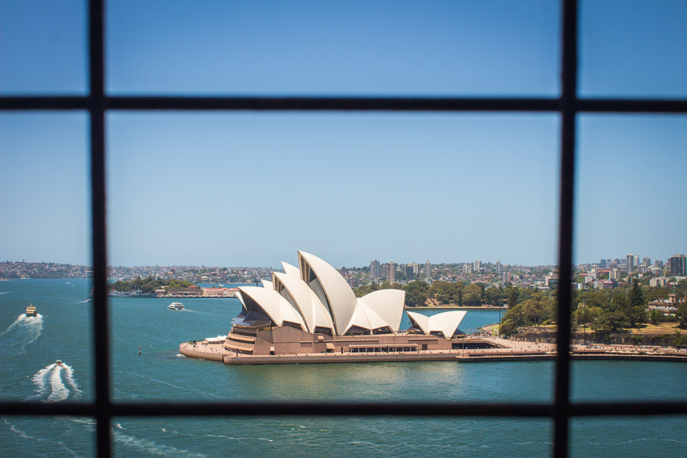 Sydney opera house through fence