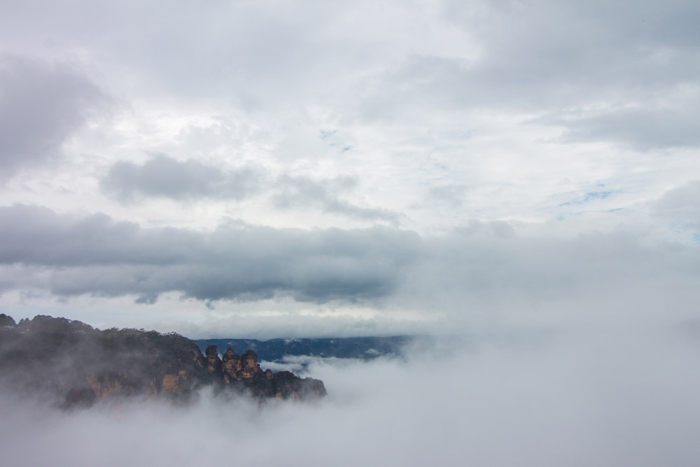 Three sisters in foggy Blue Mountains