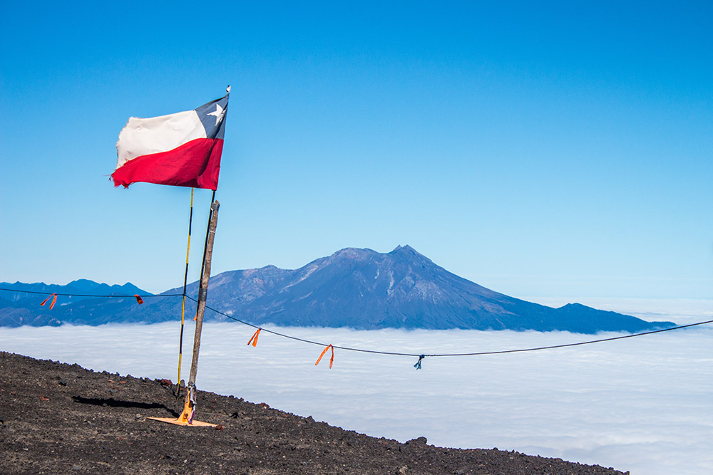 Flag on vulcano Osorno